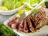 sliced steak with balsamic vinegar and green salad