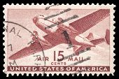 USA-CIRCA 1941: A 15 cent United States Airmail postage stamp shows image of a twin-engined transpor