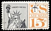 USA-CIRCA 1961: A 15 cent United States Airmail postage stamp shows image of The Statue of Liberty,