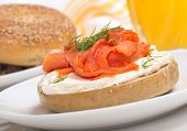 Delicious freshly baked Everything Bagel with cream cheese, lox and dill served with fresh orange ju