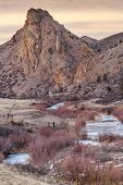 winter dusk in Rocky Mountains - Eagle Nest Rock and North Fork of Cache la Poudre River in northern