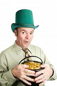 Irish leprechaun with his pot of gold, in celebration of St. Patrick's Day.  White background.