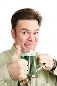 Drunk Irish man gives a thumbs up on St. Patrick's Day as he drinks a green beer.  White background.