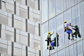 Window Washers Working On Office Building