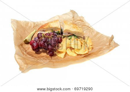 with a Turkey and Cheese Sandwich on Cheese Bread, Chips, Red Grapes ...