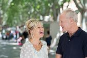 Middle-aged Couple Enjoying A Laugh In The Street