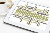 mindfulness word cloud on a digital tablet with a cup of coffee