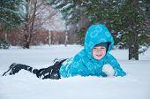 Boy In Blue Jacket Walking In A Winter Park