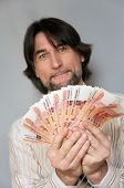 Funny Man With A Fan Of Russian Money In The Hands Of