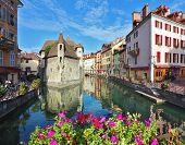 ANNECY, FRANCE - SEPTEMBER 17, 2012: Charming old town of Annecy in Provence. Clear early morning. B