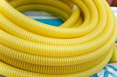 Yellow Garden Hose For Watering, Is Irregularly Wound