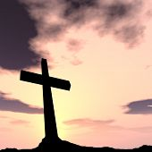 Concept conceptual black cross or religion symbol silhouette in rock landscape over a sunset or sunr