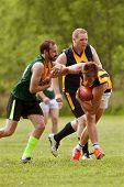 Player Avoids Being Tackled In Amateur Australian Rules Football Game