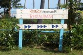 A tablet with invitation and inform to the beach restaurant in Samui island in Thailand