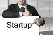 Businessman Pointing On Sign Startup