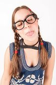 Young Nerdy And Goofy Girl Sticking Out Her Tongue.