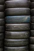 Stack Of Old Wheel Black Tyres.