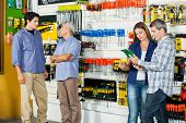 Male and female customers in hardware store