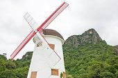 Windmill With Mountain.