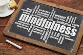 mindfulness word cloud on a vintage slate blackboard with a cup of coffee and cookie
