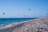 Kitesurfers On The Beach In Greece