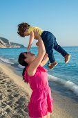 Mom Raising Child In The Sun