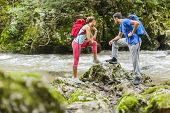 Young Couple Hiking By The River