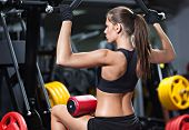 Woman Exercising On Weightlifting Machine