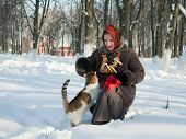 Girl In Wintry Clothes  Plays With Cat
