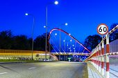 Cable stayed bridge over Brda river in Bydgoszcz at night, Poland
