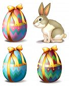 Illustration of the three colorful eggs and a cute bunny on a white background