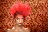Red Themed Woman With Creative Headpiece