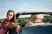 Young woman recline on the car
