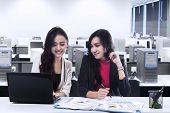 Two Young Businesswomen In Office