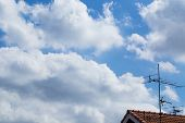 Antenna Tv With Clouds In The Blue Sky .
