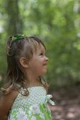 pic of little girls photo-models  - Cute little girl smiling in an outdoor blurry background - JPG