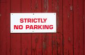 no parking sign on red wood background texture