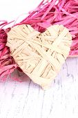 Decorative straw for hand made and heart of straw, on wooden background