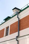 picture of downspouts  - Rain gutter and downspout newly installed on historic building - JPG