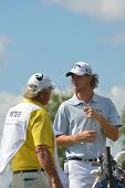 TSELEEVO, MOSCOW REGION, RUSSIA - JULY 26, 2014: Thomas Pieters of Belgium with his caddy during the