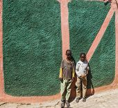 Harar, Ethiopia - December 24, 2013: Unidentified Children Posing In Typical Surroundings In Ancient