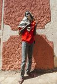 Harar, Ethiopia - December 24, 2013: Unidentified Young Man Posing In Typical Surroundings In Ancien