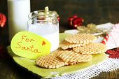 Cookies and milk for Santa. on wooden background