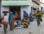 Harar, Ethiopia - December 24, 2013: Unidentified People Of Ancient Walled City Of Jugol In Their Da