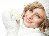 attractive young caucasian woman in warm clothing  studio shot isolated on white smiling winter rose flower