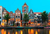 Night City View Of Amsterdam Canals And Typical Houses, Holland, Netherlands.