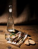 Glass Of Vodka With Dried Capelin And Bread