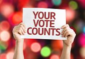 stock photo of debate  - Your Vote Counts card with colorful background with defocused lights - JPG