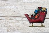 Christmas Background With A Santa Sleigh On Grunge Textured Wood Background