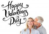 Affectionate man kissing his wife on the cheek against happy valentines day